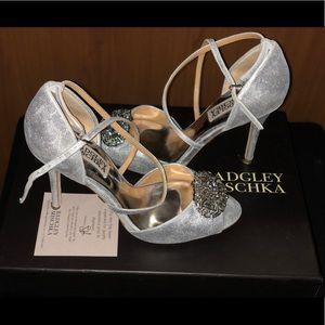Silver cross strap sandals.